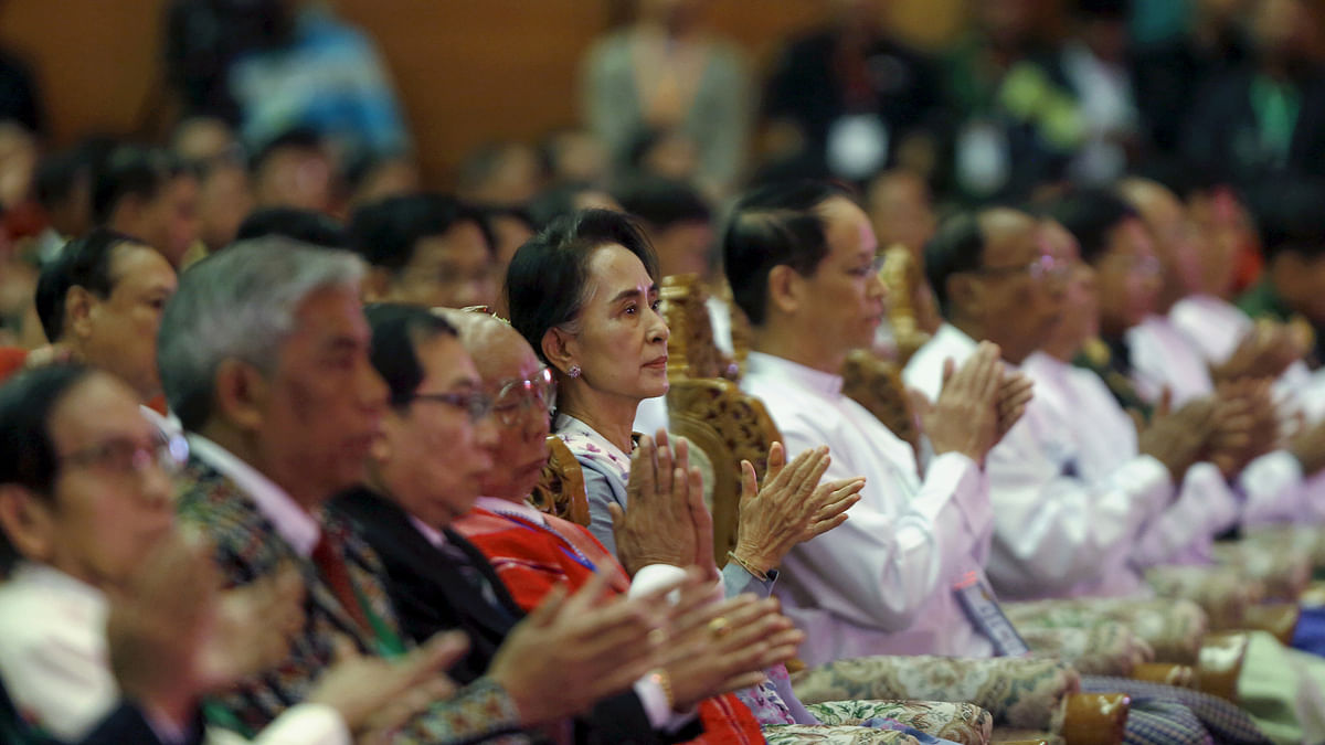 Myanmar's Aung San Suu Kyi claps after Myanmar's Commander-in-Chief Senior General Min Aung Hlaing's speech in the Naypyitaw talks.      (Photo: Reuters)