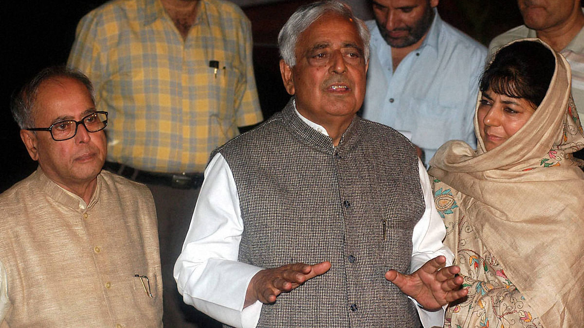 File photo of Mufti Mohammad Sayeed with his daughter Mehbooba Mufti and then Defence Minister Pranab Mukharjee after a meeting with UPA Chairperson Sonia Gandhi in New Delhi in October 2005. (Photo: PTI)