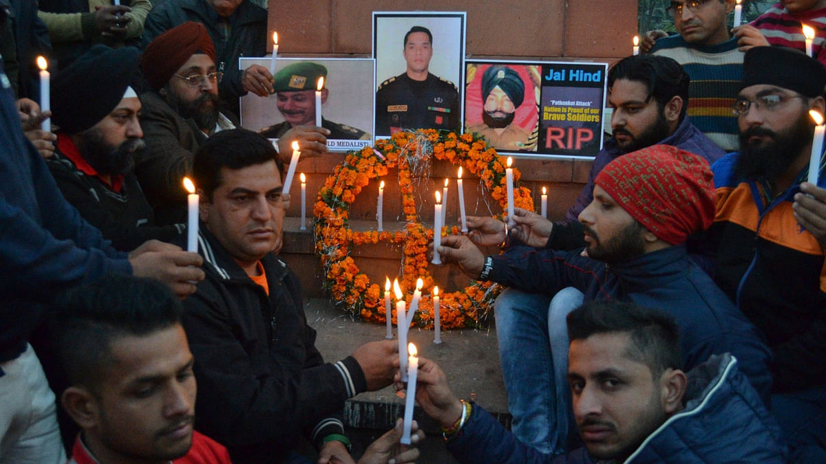People pay tribute to slain soldiers in the Pathankot air base attack. (Photo: IANS)