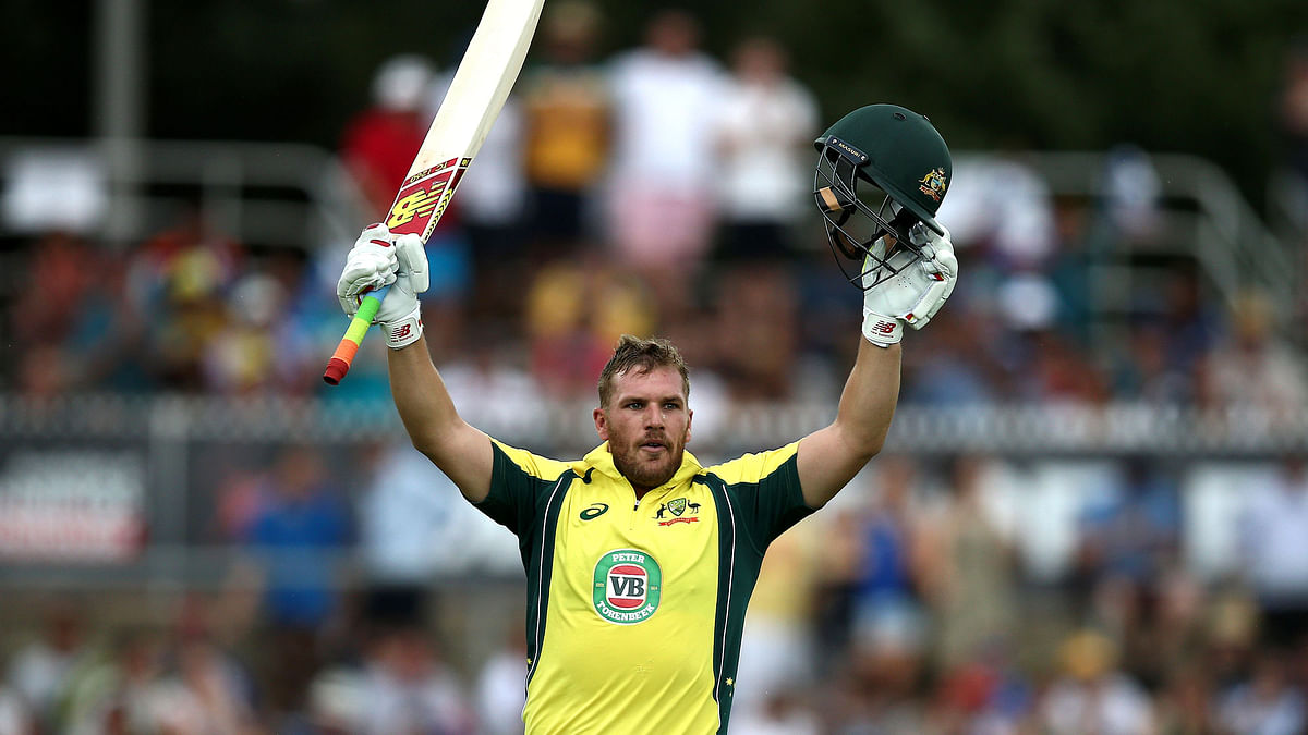 Aaron Finch celebrates his century in  Canberra vs India. (Photo: AP)