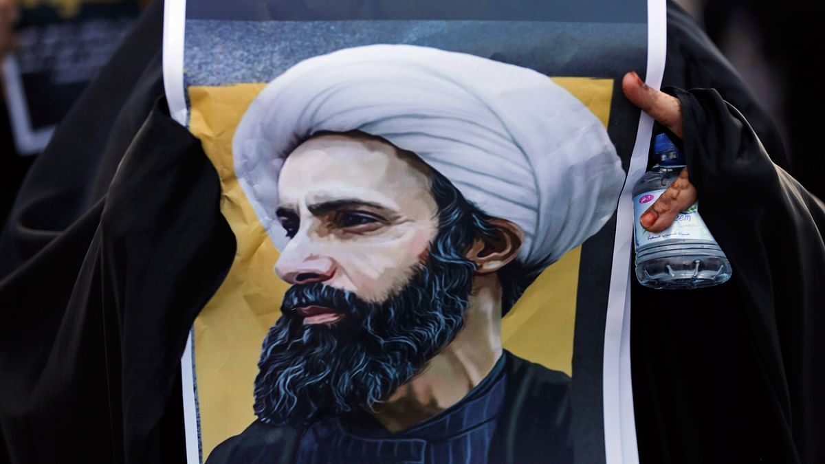 A protester holding a poster depicting Shiite cleric Sheikh Nimr al-Nimr, who witj 46 others, was executed by Saudi Arabia. (Photo: AP)