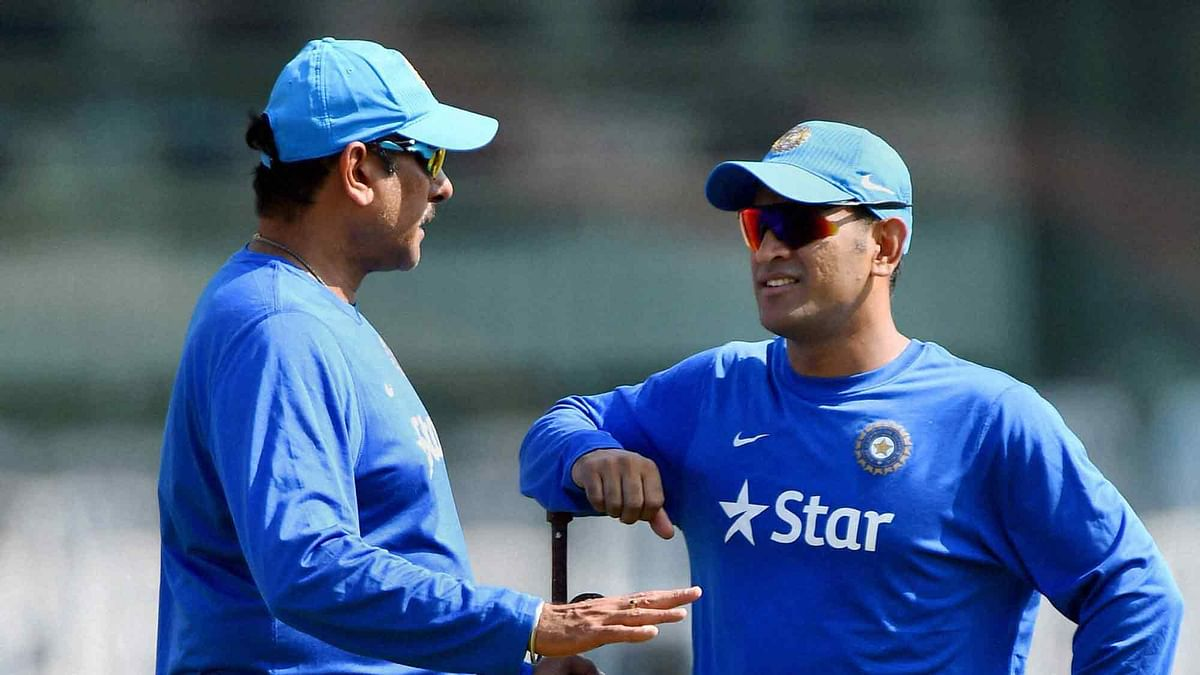 File photo of MS Dhoni with Indian team's manager Ravi Shastri. (Photo: PTI)