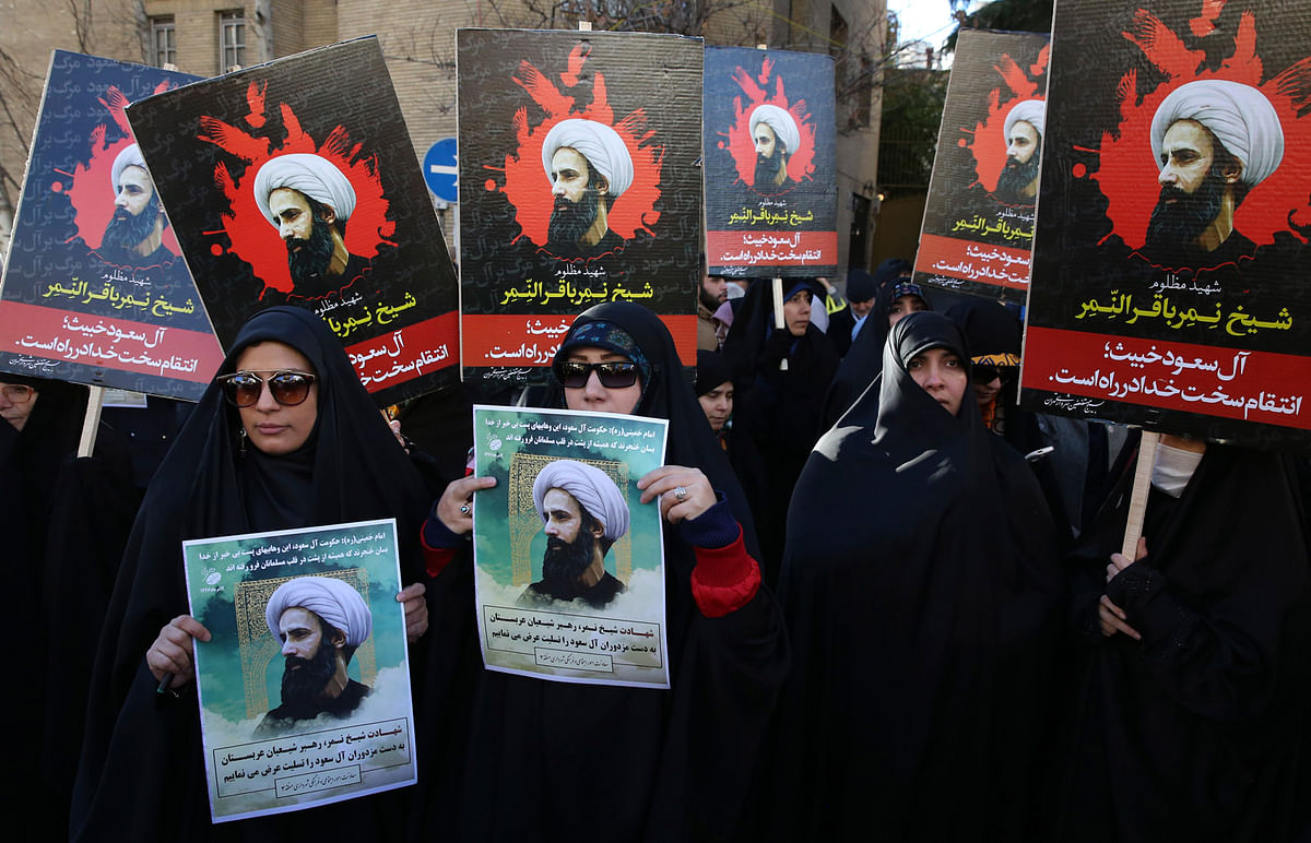 Iranian demonstrators hold posters of Sheikh Nimr al-Nimr, a prominent opposition Saudi Shiite cleric, during a protest denouncing his execution, in front of the Saudi Embassy, in Tehran. (Photo: AP)