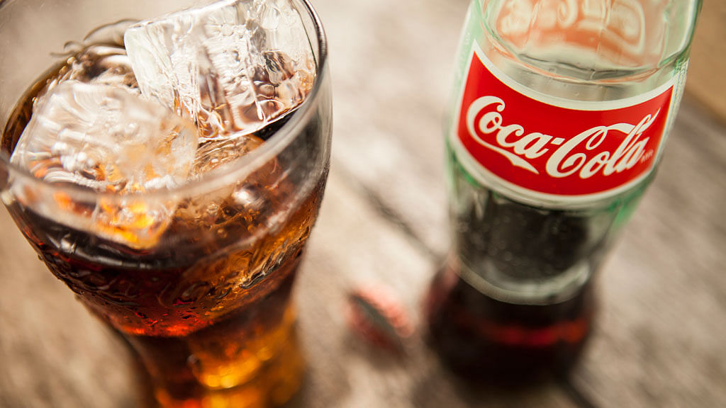 Within 20 minutes of drinking Coke, your blood sugar spikes, causing an insulin burst. (Photo: iStockphoto)