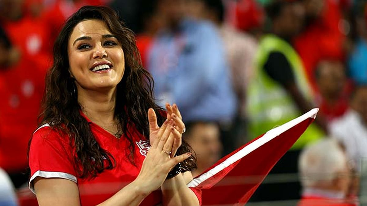 Co-owner Preity Zinta cheering on her IPL team Kings XI Punjab at a match.