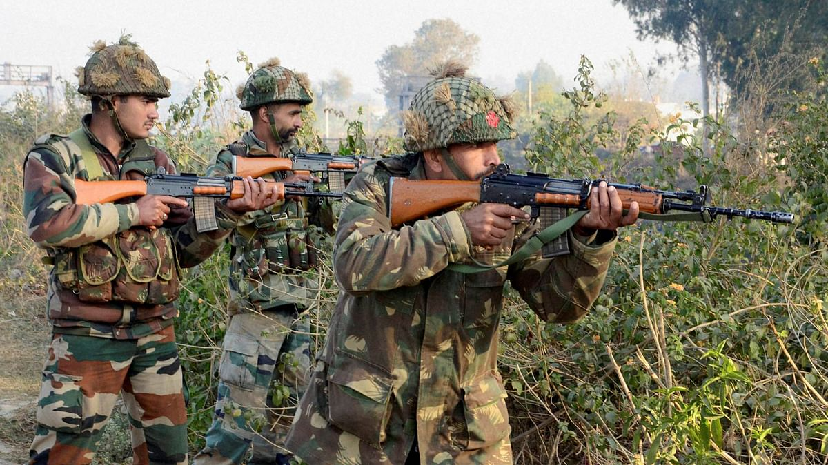Army soldiers conduct a search operation in a forest area outside the Air Force Base in Pathankot on Sunday. (Photo: PTI)