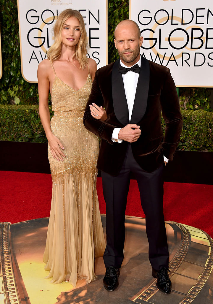 Huntington-Whiteley and Statham have been dating for five years. She was seen at the Golden Globes sporting a diamond ring on her finger. (Photo: AP)