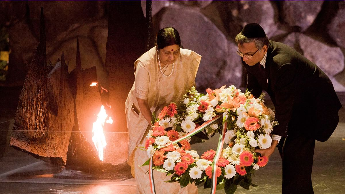 Minister of External Affairs, Sushma Swaraj, left, lay a wreath at the Hall of Remembrance at the Yad Vashem Holocaust memorial, in Jerusalem, Monday, January 18, 2016. (Photo: AP)