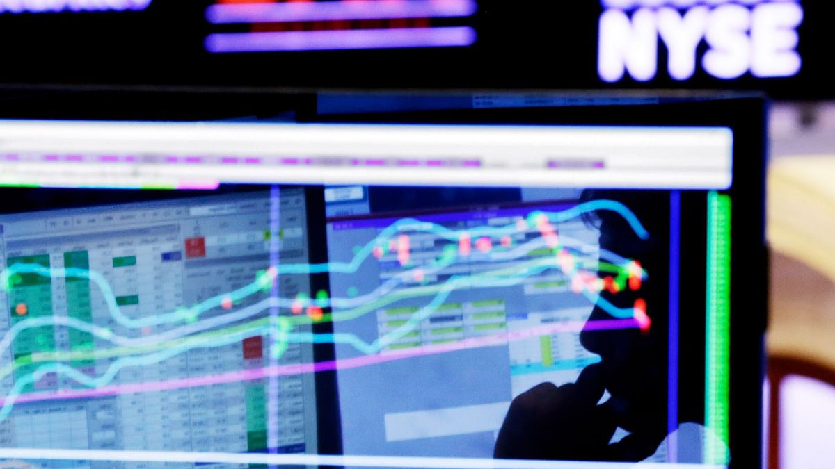 Specialist Anthony Rinaldi is silhouetted on a screen at his post on the floor of the New York Stock Exchange, Monday, January 11, 2016. (Photo: AP)