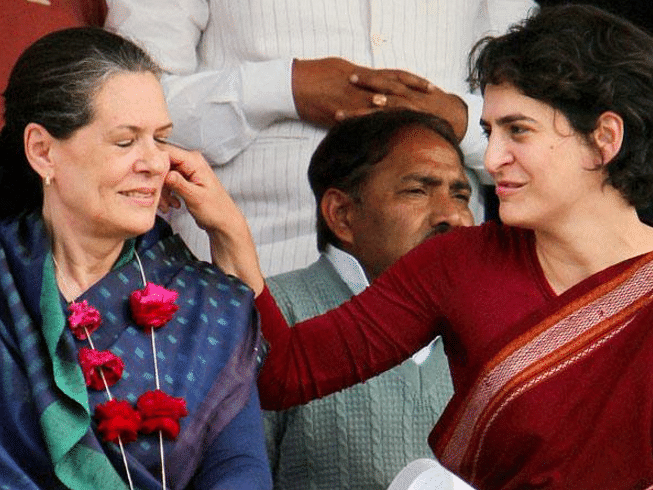 """Priyanka Gandhi pulls Sonia Gandhi's cheeks during a public rally. (Photo Courtesy: Twitter/<a href=""""https://twitter.com/search?f=images&amp;vertical=default&amp;q=Priyanka%20Gandhi%20Sonia%20Gandhi&amp;src=typd"""">@Butchikotaiah</a>)"""