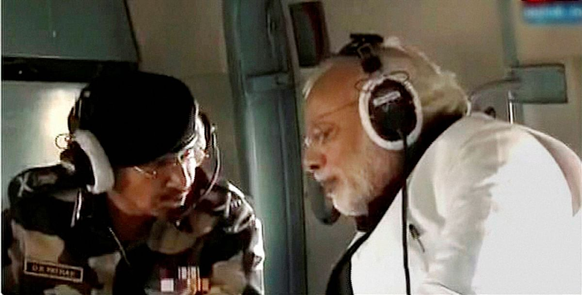 PM Modi conducting an aerial survey of the Pathakot air base. (Photo: PTI)