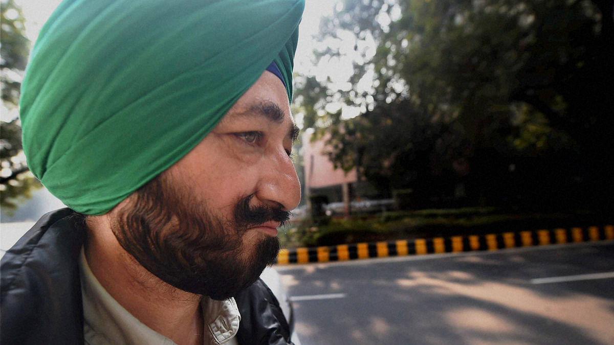 Gurdaspur SP Salwinder Singh, who was allegedly abducted by terrorists involved in the Pathankot attack, arrives to appear before NIA in New Delhi on Tuesday for a questioning in connection with the terror strike. (Photo: PTI)