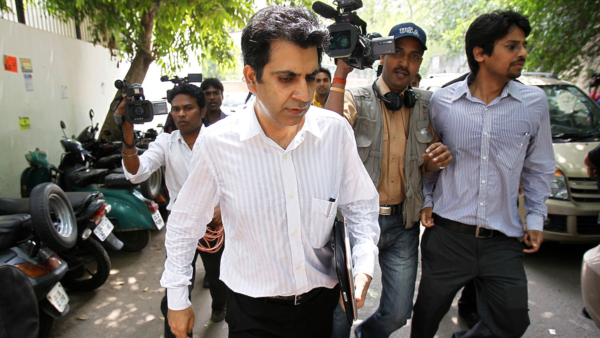 In this file photo, Unitech Ltd Chairman Ramesh Chandra (C) is seen leaving a court in New Delhi. (Photo: Reuters)