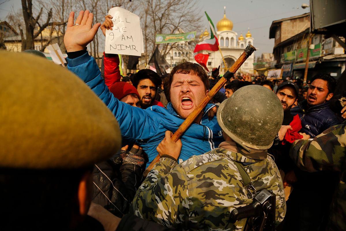 A Kashmiri Shiite Muslim shouts slogans as police stop them during a protest against Saudi Arabia in Srinagar. (Photo: AP)