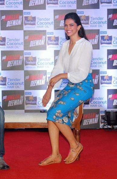 "Deepika Padukone rocks the mid-length skirt look here, with the loud floral print and the plain white shirt. (Photo Courtesy: <a href=""https://www.facebook.com/YehJawaaniHainDeewani/photos_stream"">Facebook/Yeh Jawaani Hai Deewani</a>)"