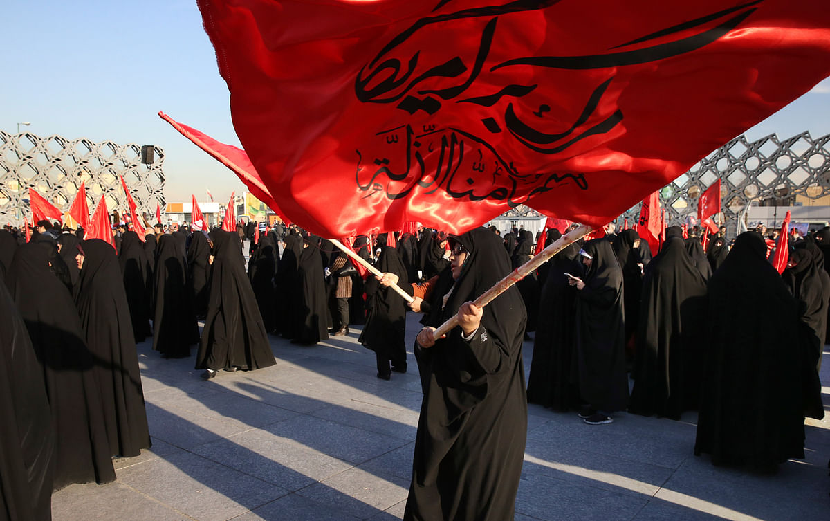 "Iranian women wave flags that read, ""Death to America and we shall never accept humiliation,"" during a rally to protest the execution by Saudi Arabia last week of Sheikh Nimr al-Nimr, a Saudi Shiite cleric. (Photo: AP)"