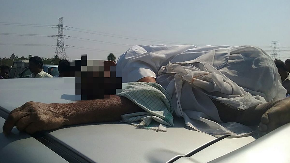 The dead man atop the car. (Photo: The News Minute)