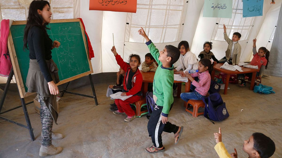Syrian refugee children attend a class inside a makeshift school supported by UNICEF. (Photo: Reuters)