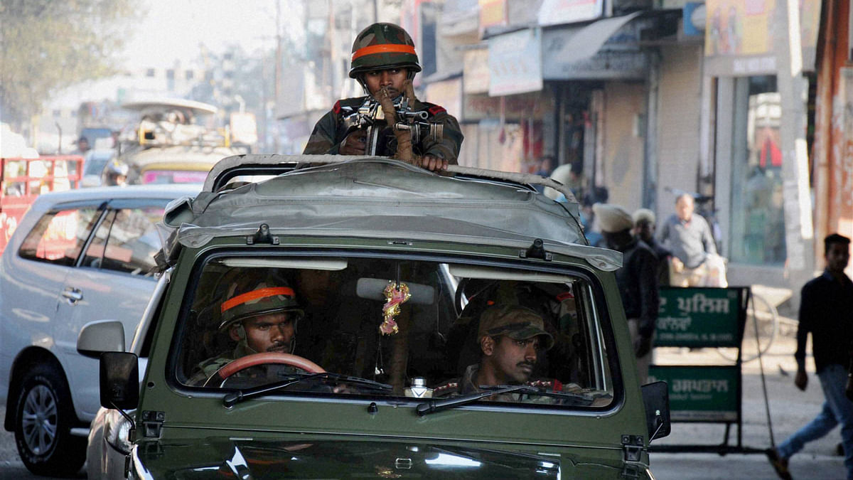 Indian soldiers stand guard outside the air base in Pathankot, Punjab. (Photo: PTI)
