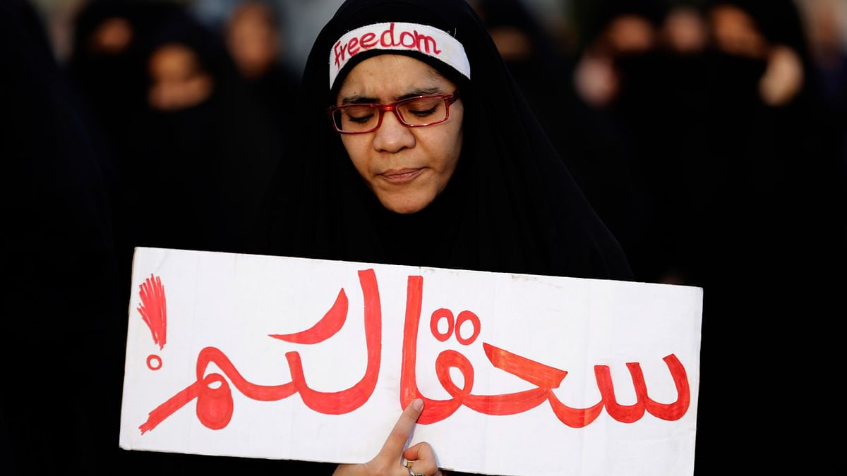 """In this January 2, 2016 file photo, a Bahraini anti-government protester holds a banner in Arabic that reads, """"damn you"""" during a demonstration against Saudi Arabia's execution of Shia cleric Sheikh Nimr al-Nimr, in Daih, Bahrain. (Photo: Reuters)"""