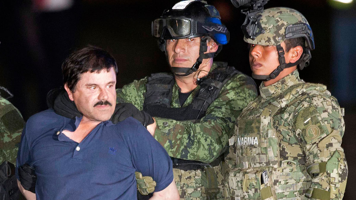 Mexican drug lord El Chapo paraded in front of the cameras by the police. (Photo: AP)