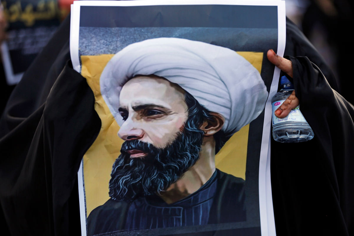 A Bahraini protester holds a picture of Saudi Shiite cleric Sheikh Nimr al-Nimr during a rally denouncing his execution in Daih, Bahrain. (Photo: AP)