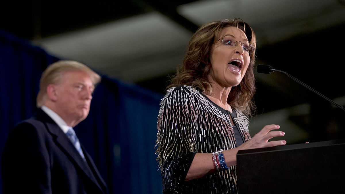 Former Alaska Governor Sarah Palin, right, endorses Republican presidential hopeful Donald Trump during a rally at the Iowa State University, Tuesday, January 19, 2016, in Ames, Iowa. (Photo: AP)