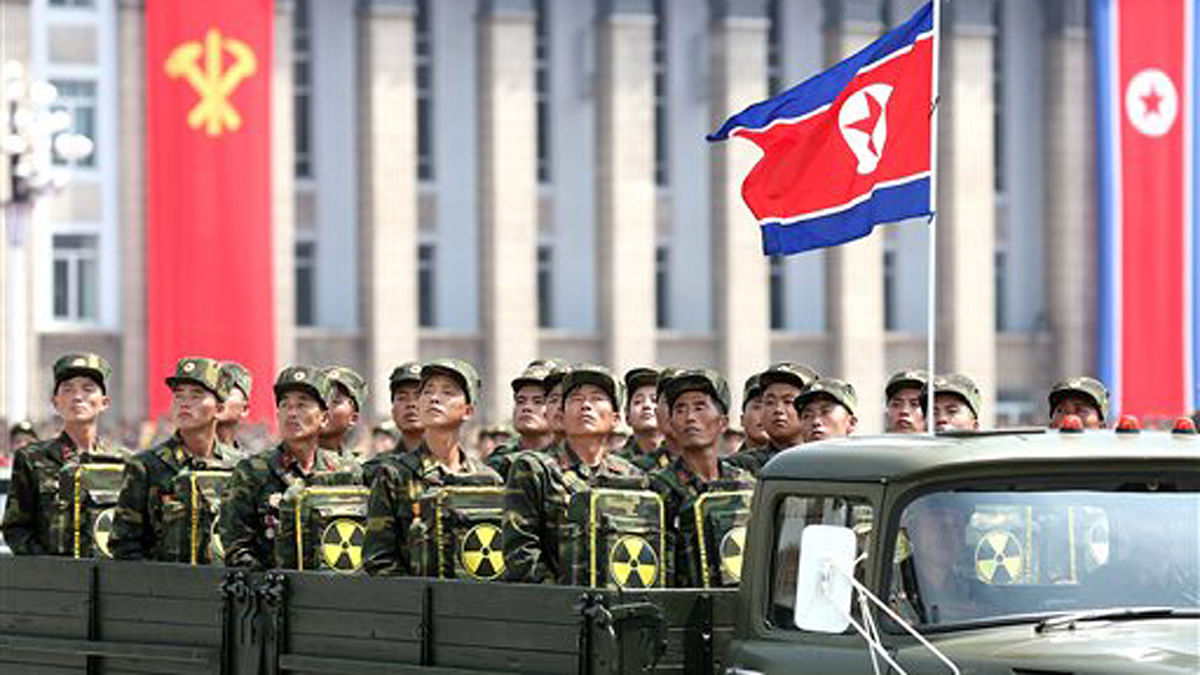 North Korean soldiers carry packs marked with the nuclear symbol. (Photo: AP)