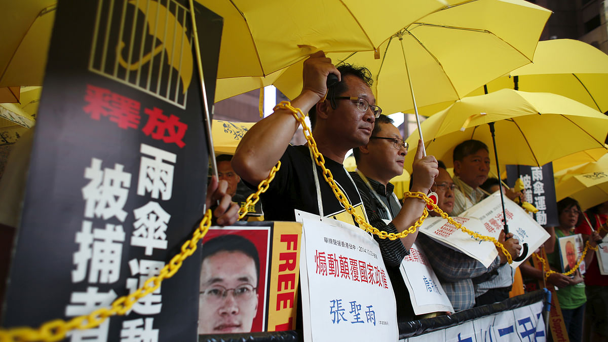Pro-democracy protesters demanding the release of mainland activists take part in a rally in Hong Kong on 23 July  2015. (Photo: Reuters)