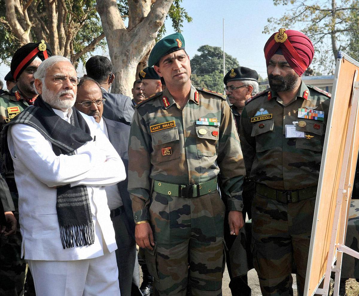 PM Modi inspecting the Pathankot air base. (Photo: PTI)
