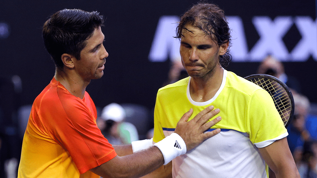 Fernando Verdasco consoles Rafael Nadal in the first round of the 2016 Australian Open. (Photo: AP)