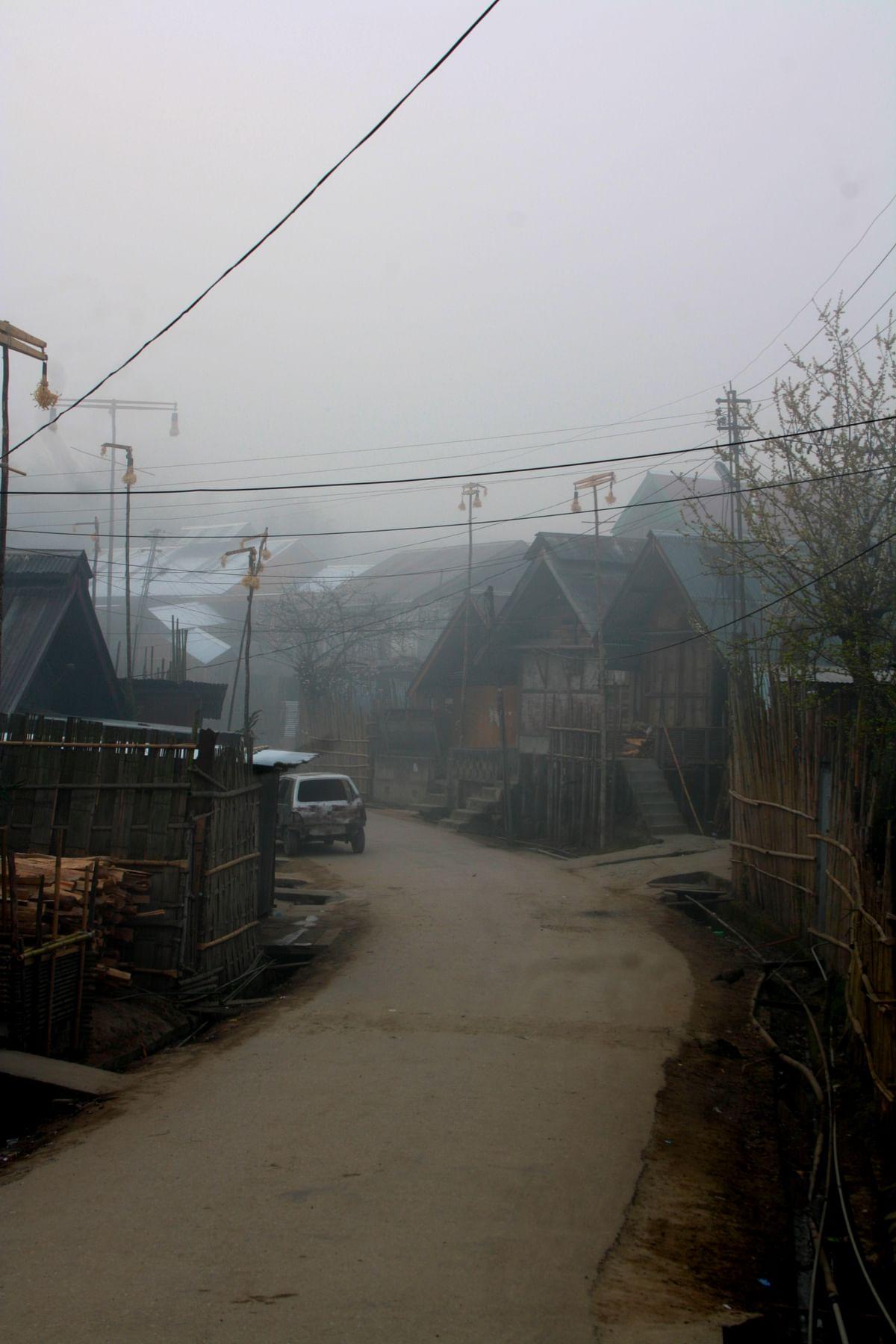 Walking through a village in the morning fog. (Photo Courtesy: Kushal Chowdhury)