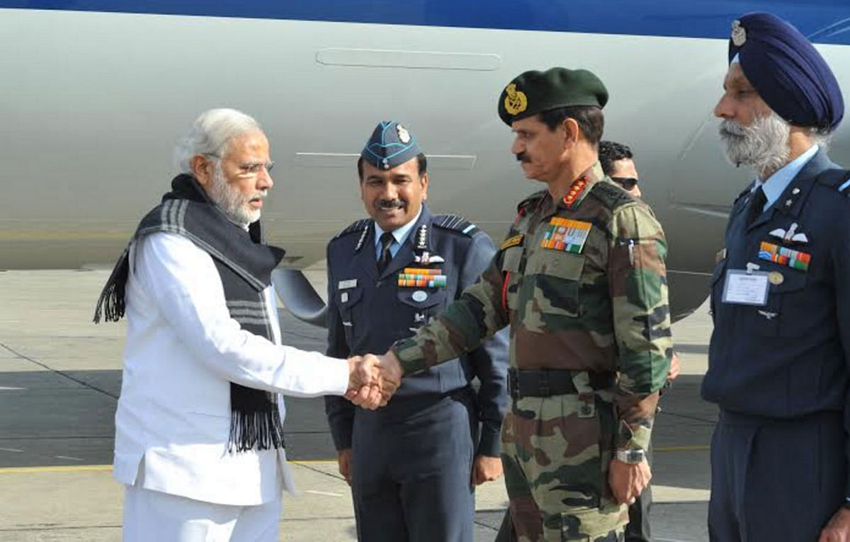 PM Modi received at the air base in Pathankot. (Photo: Twitter.com/@PIB_India)