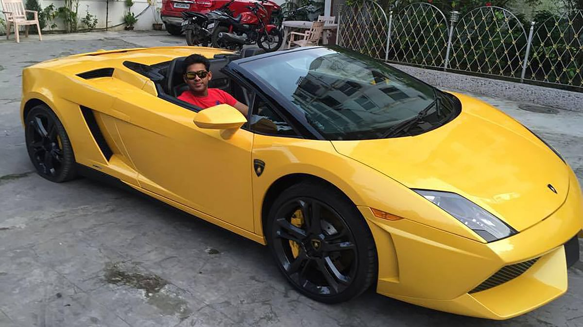 """Posing in one of his many swanky cars is Ambia Sohrab, brother of Sambia Sohrab, who allegedly ran over and killed the IAF officer in Kolkata. (Photo: <a href=""""https://www.facebook.com/photo.php?fbid=877320182336365&amp;set=a.303481266386929.65638.100001751742452&amp;type=3&amp;theater"""">facebook</a>)"""