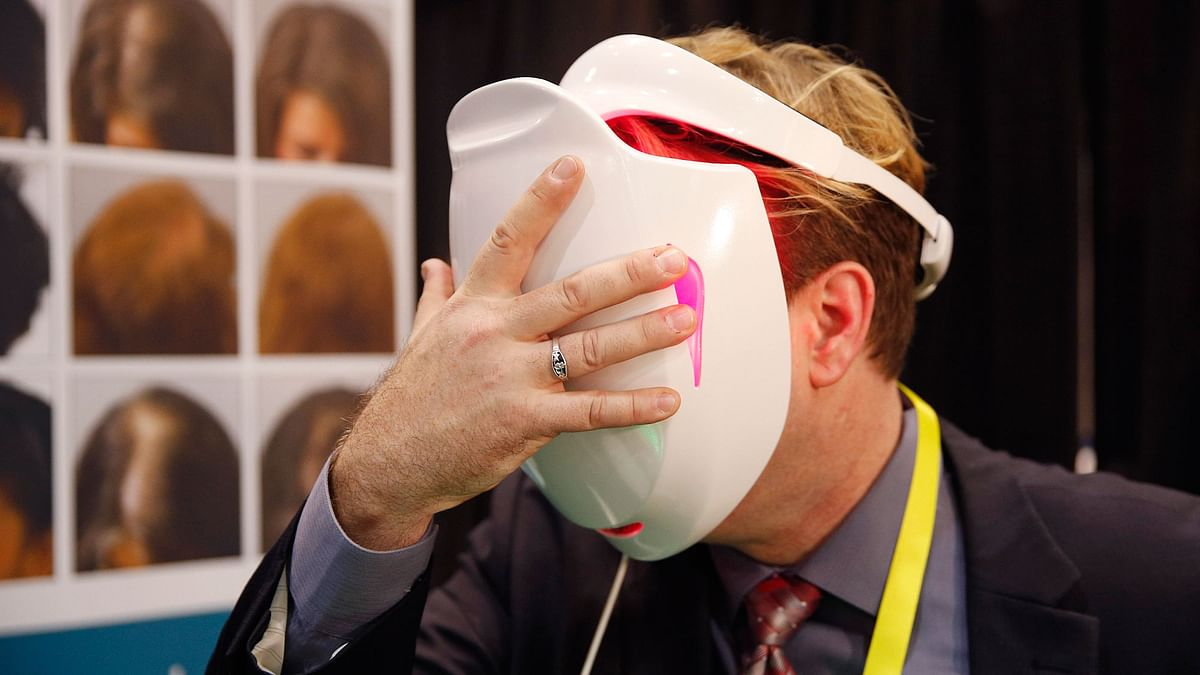 Jonathon Graff demonstrates the Apira Science iDerma light therapy device at CES Unveiled, a media preview event for CES International, Monday, Jan. 4, 2016, in Las Vegas. The device uses low-level light to treat skin conditions. (Photo: AP/John Locher)