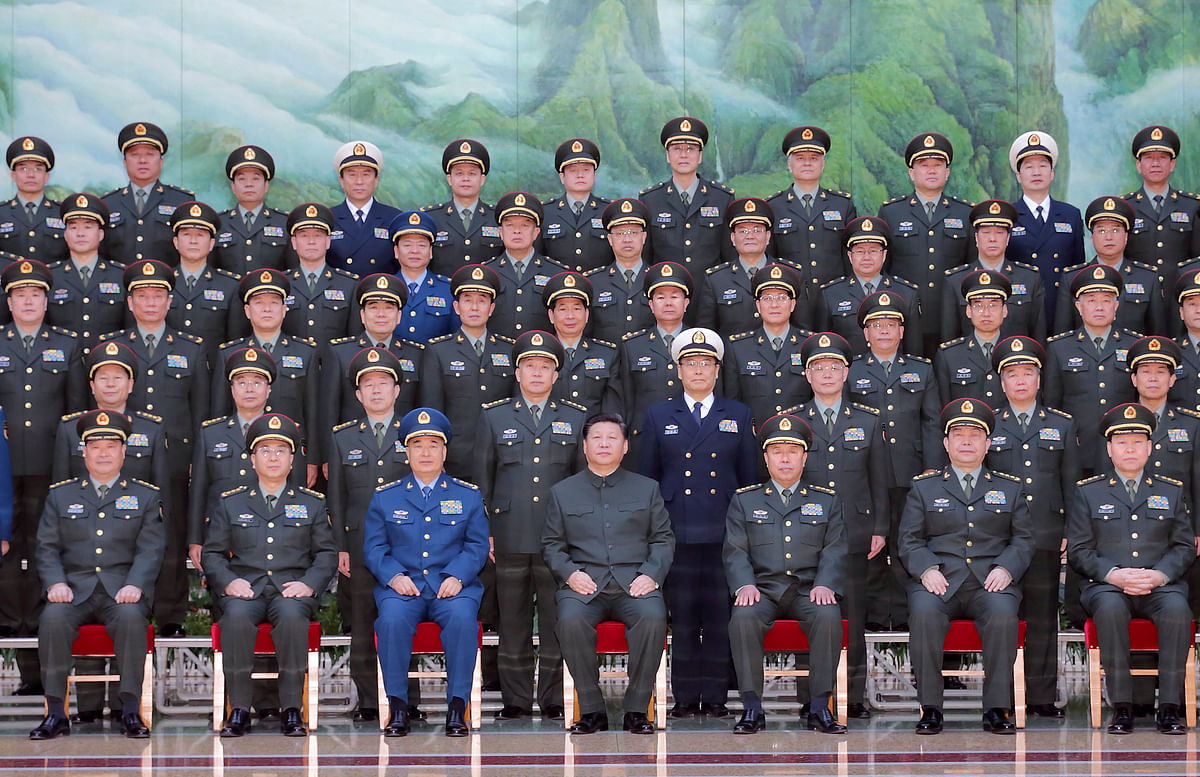 In this photo provided by China's <i>Xinhua</i>, Chinese President Xi Jinping, center front, poses for a group photo during a meeting with the new heads of the reorganised organs of the Communist Party's Central Military Commission in Beijing, Monday, January 11, 2016. (Photo: AP)