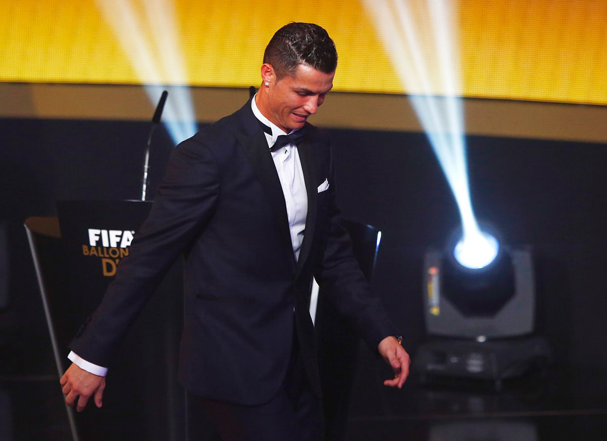 Real Madrid's Cristiano Ronaldo walks  off the stage, following the declaration of the winner of the player of the year award. (Photo: Reuters)