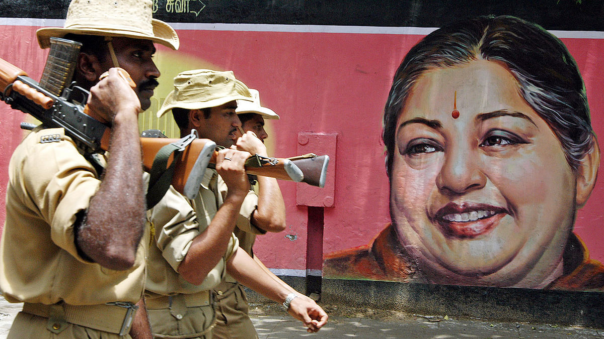 Chennai police officers are seen here, with a poster of Chief Minister of Tamil Nadu, J Jayalalitha, in the background. (Photo: Reuters)