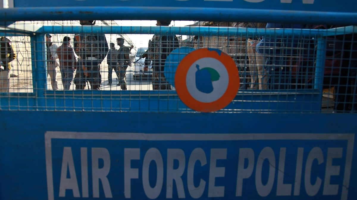 Security forces stand guard near a road barrier outside the air force base in Pathankot, Saturday, 2 January 2016. (Photo: AP)