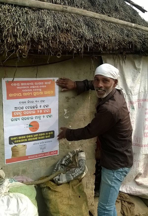 """BJP has initiated a poster campaign against the state government over anomalies in the distribution of ration cards. (Photo Courtesy: @<a href=""""https://twitter.com/BJPOdisha"""">BJPOdisha</a>/Twitter)"""