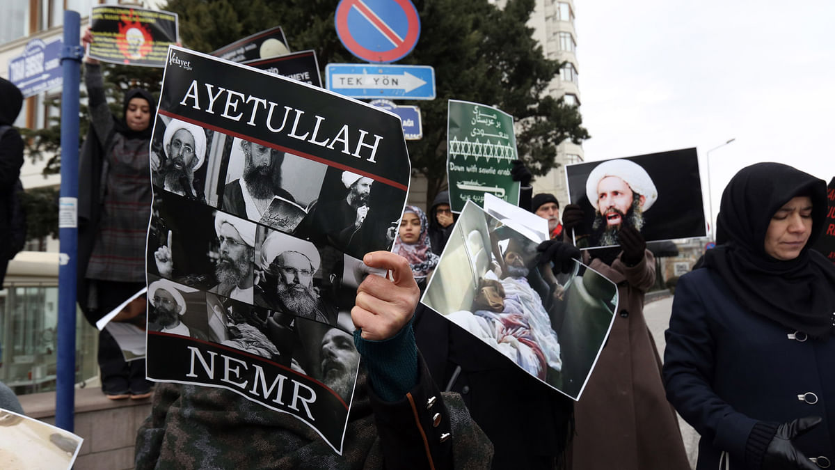 In this January 3, 2016 file photo, Iranian and Turkish demonstrators hold pictures of Shia cleric Sheikh Nimr al-Nimr as they protest outside the Saudi Embassy in Ankara, Turkey. (Photo: AP)