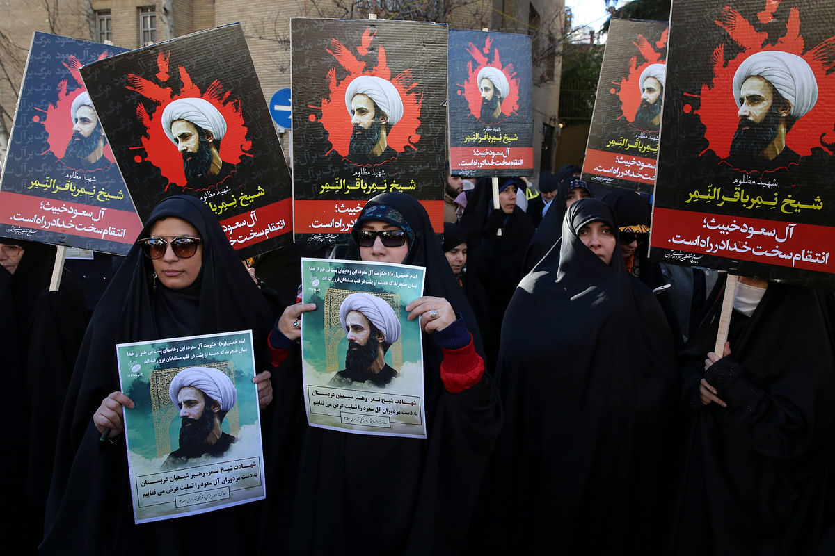 Iranian demonstrators hold posters of Sheikh Nimr al-Nimr, during a protest denouncing his execution, in front of the Saudi Embassy, in Tehran. (Photo: AP)