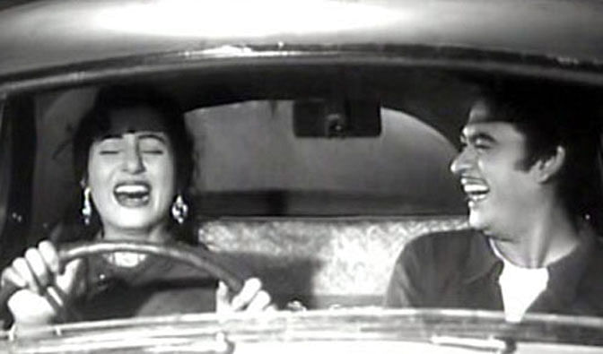 Madhubala and Kishore Kumar in a comic scene from <i>Chalti Ka Naam Gaadi.</i>