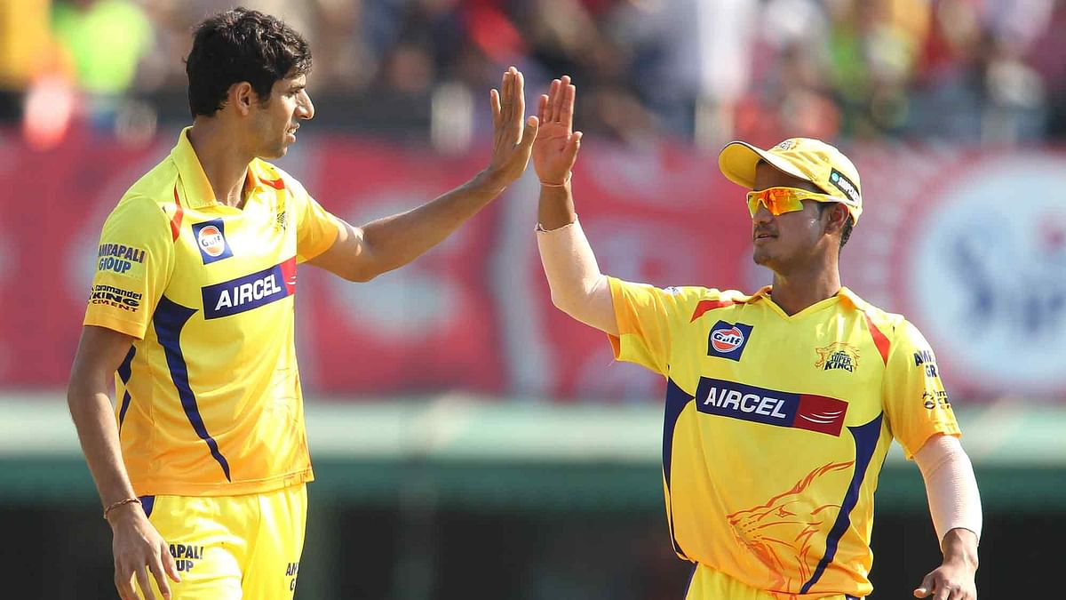Ashish Nehra and Pawan Negi during a game for CSK in the IPL. (Photo: Ron Gaunt / SPORTZPICS / IPL)