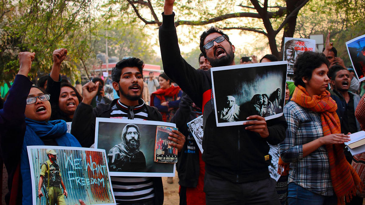 """JNU students at the controversial event. (Photo Courtesy: <a href=""""https://www.facebook.com/reyaz.hashiya?fref=photo"""">Reyazul Haque's Facebook Page</a>)"""