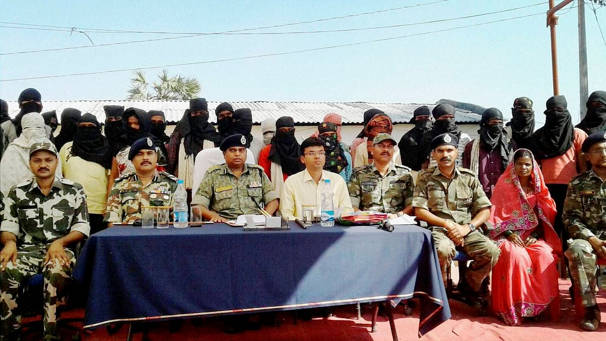 Naxals surrendered to Inspector General of Police SRP Kaluri in Sukma, on Tuesday. (Photo: PTI)