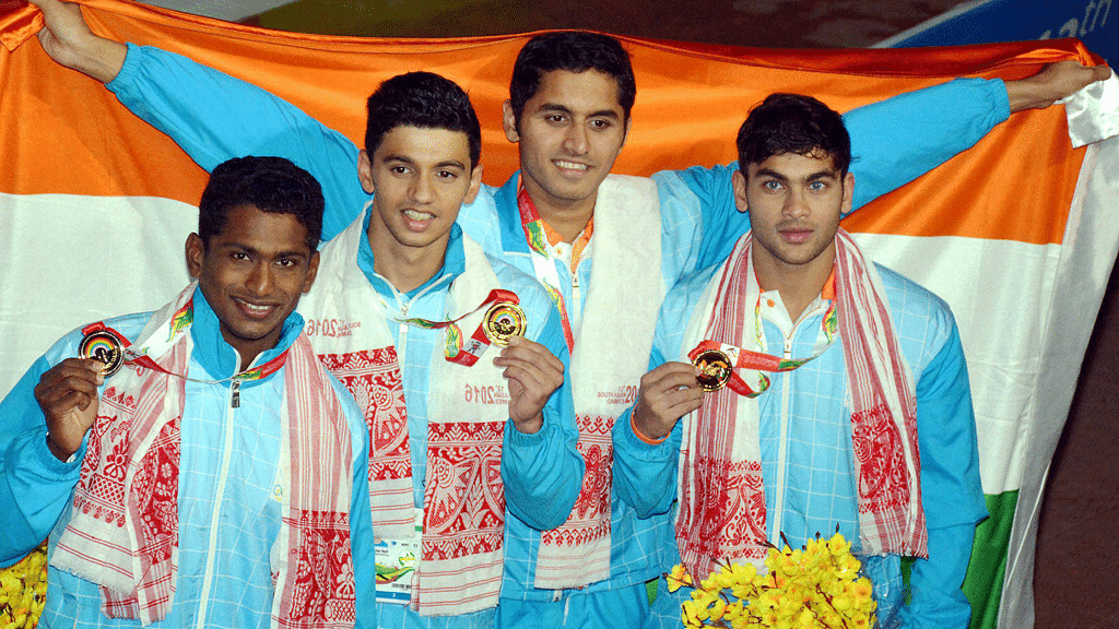 Gold medal winning Indian team after men's 4x200m freestyle swimming event at the 12th South Asian Games 2016 in Guwahati on Tuesday. (Photo: PTI)