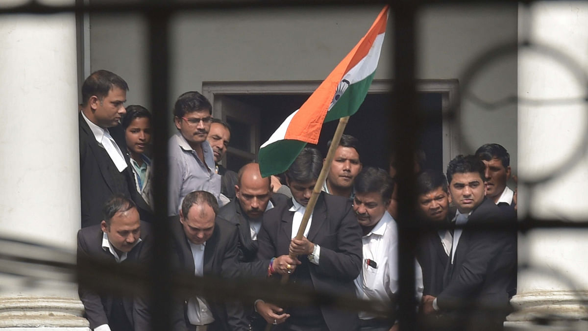 Lawyers wave tri-colour at Patiala House Court where JNU student leader Kanhaiya Kumar,  who was arrested on a sedition charge, was produced in New Delhi, on February 17, 2016. (Photo: PTI)