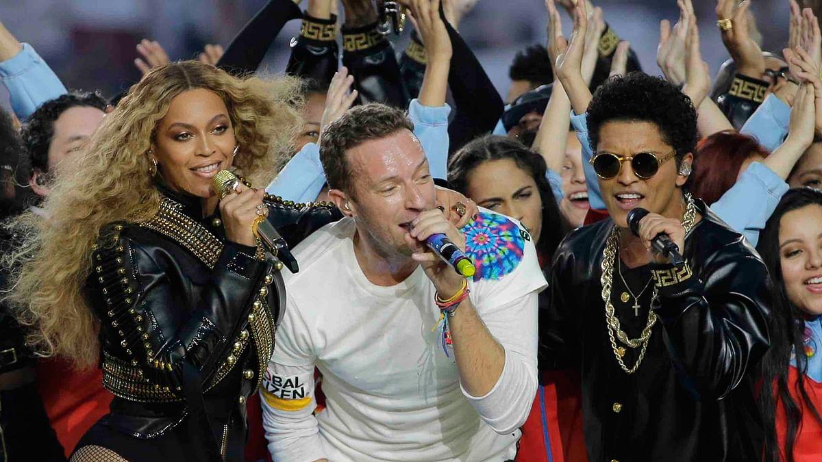 Beyoncé, Chris Martin and Bruno Mars perform at Super Bowl 50 (Photo: AP)