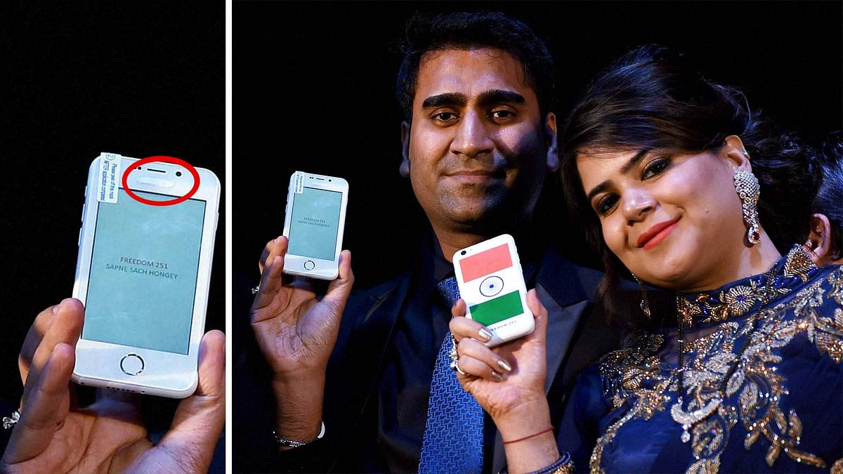 Ringing Bells Director Mohit Goel with CEO Dhaarna Goel during the launch event, holding Freedom 251. (Photo: PTI)